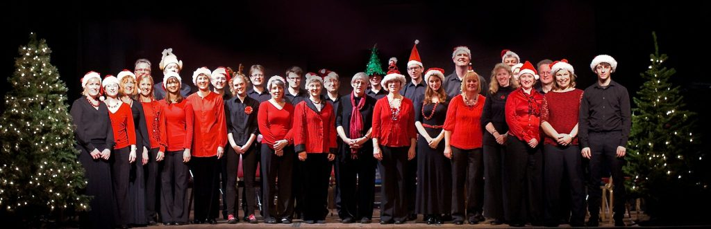 The Lea Singers on stage at Harpenden Public Halls at Christmas