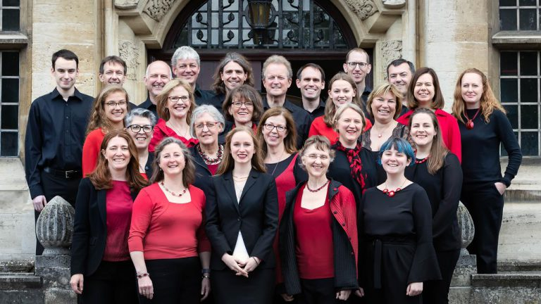 The Lea Singers chamber choir of Harpenden on the steps of Academy St Albans in June 2019
