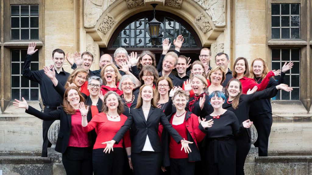 The Lea Singers do jazz hands on the steps of Academy St Albans in June 2019